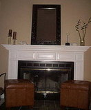 The family room with fireplace mantle.