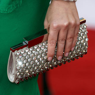 Guess the Celebrity by Her Sizzling Clutch!