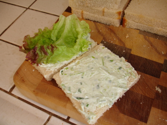 Lay the lettuce flat between the two pieces of bread