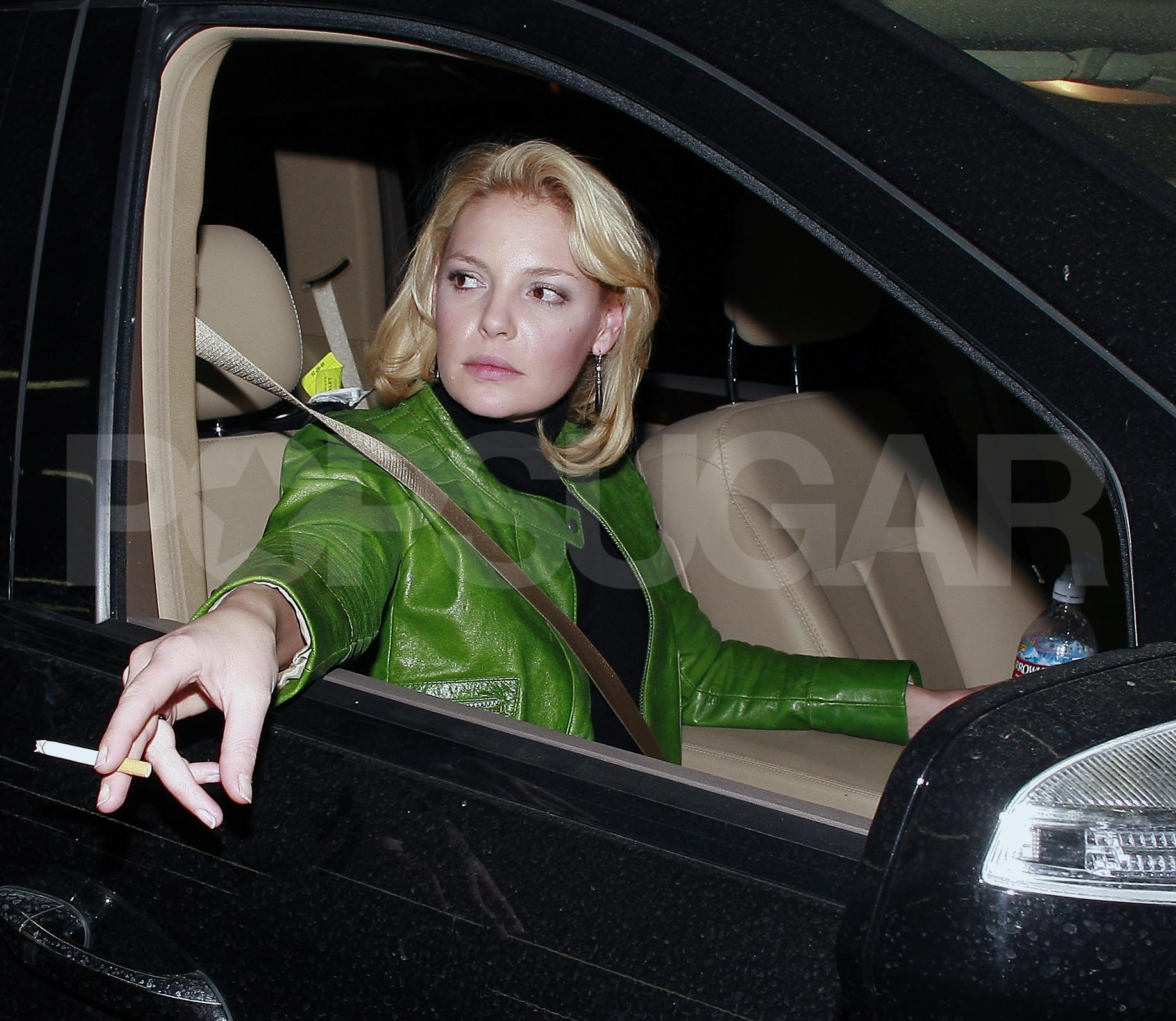 Katherine Heigl smoking a cigarette (or weed)