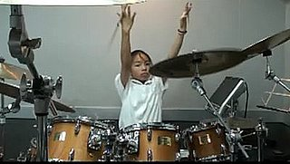 "13-Year-Old Badass Drummer Rocks Rush's ""YYZ"""