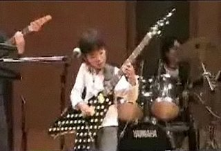Little Kid Will Kick Your Butt in Guitar Hero