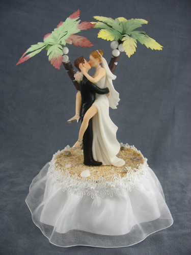 Yes you may be having a tropical themed wedding, but really it doesn't get a lot tackier than bride and groom make-out club on a tropical island ($56.95) cake topper.