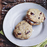 This recipe for Oatmeal-Cranberry Cookie Sandwiches has replaced raisins with cranberries, and added a devilishly tasty cream cheese filling.