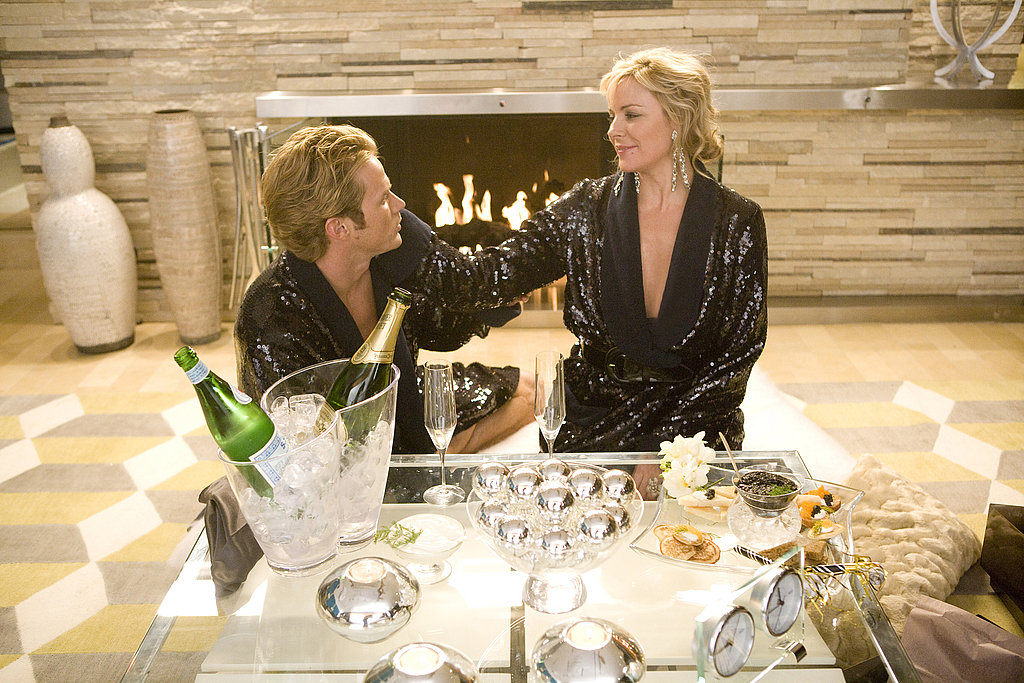 If you're going to wear matching His and Hers sequined bath robes might as well do it while sipping Champagne and eating blinis with caviar. The double bottle glass ice bucket is beyond fabulous.