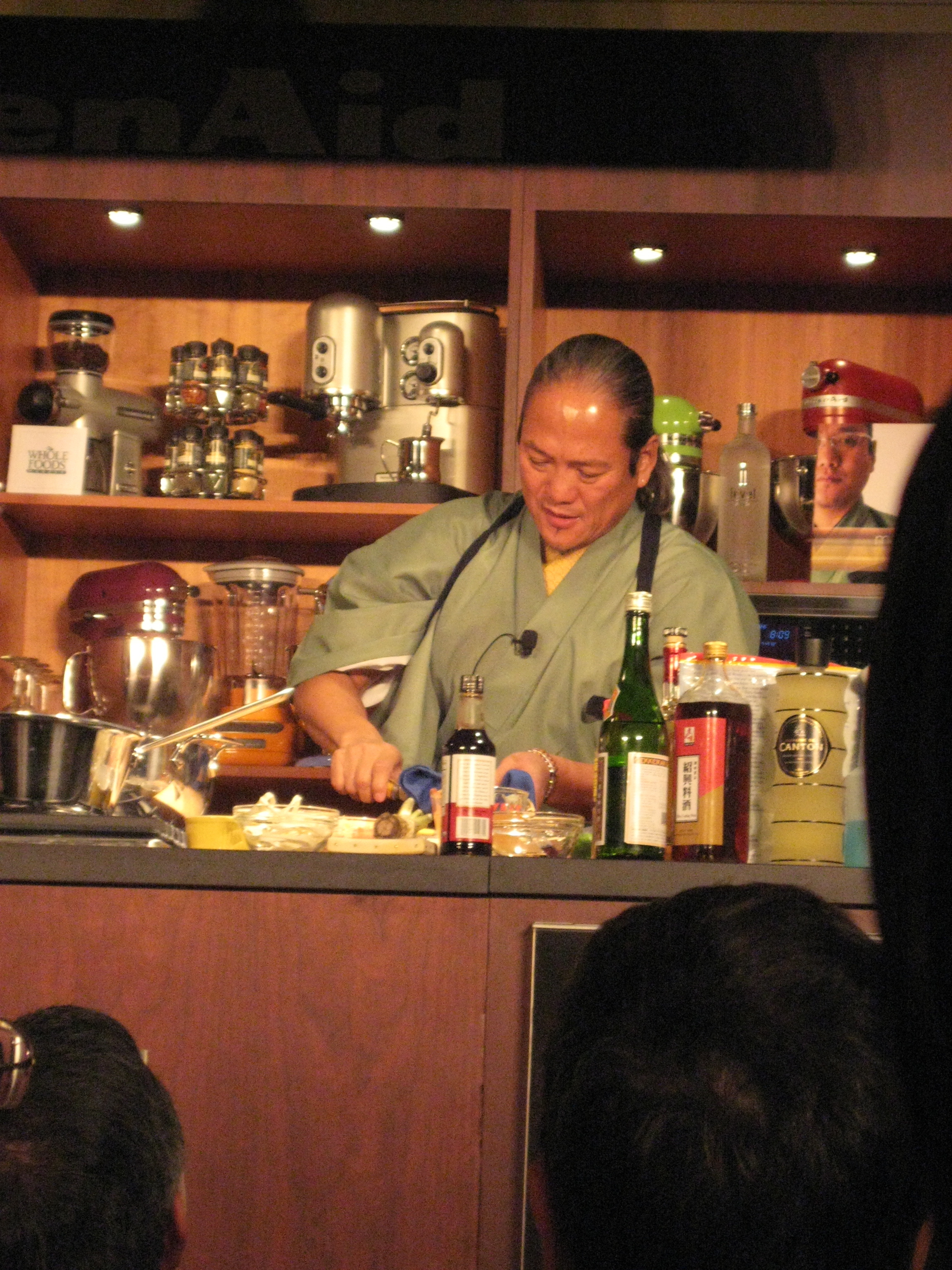 Morimoto rolls sushi.