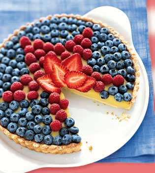 Channel the spirit of the flag with this white balsamic custard tart with star shaped berry topping.
