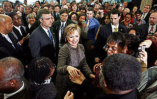 Briefing Book! Secretary of State Clinton Gets Warm Welcome