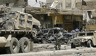 Iraqi Police: Double Suicide Attack Kills 35, Wounds 65