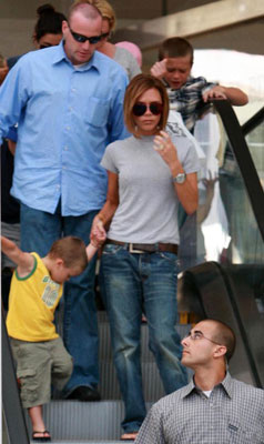 Victoria and Her Boys Ride the Escalator