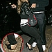 Fall from grace: Fergie trips over in her towering heels