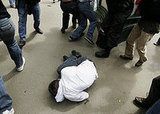 A member of the Russian gay community lies on a ground after he was beaten by a far-right activist.