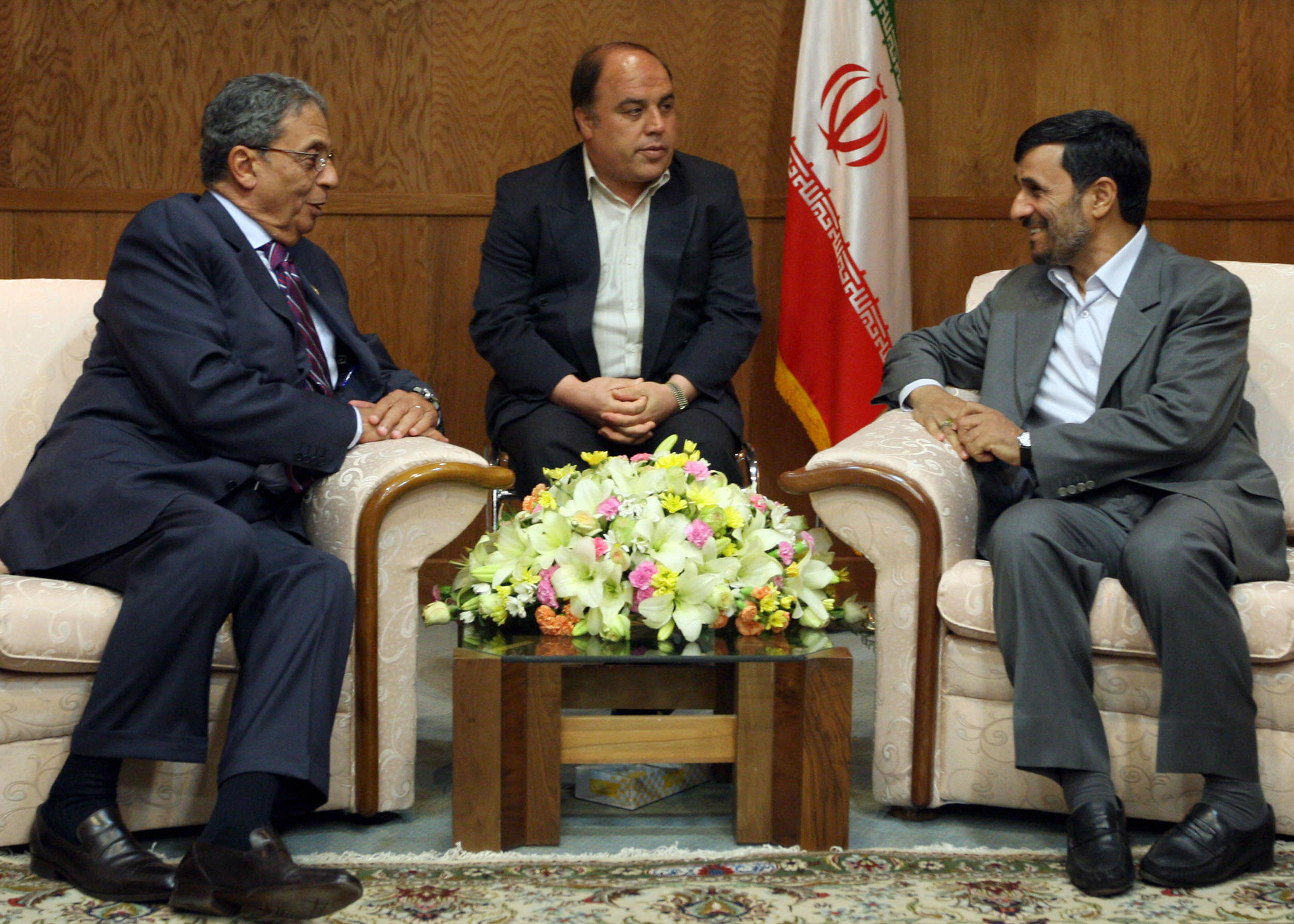 Iranian President Mahmoud Ahmadinejad meets with Arab League Secretary General Amr Mussa (L).