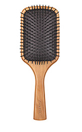 What Does a Paddle Brush Do?