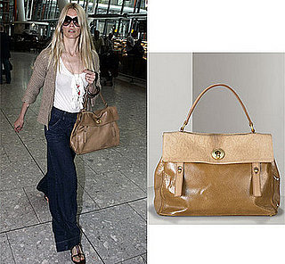Claudia Schiffer Shows Off her YSL Muse Tote