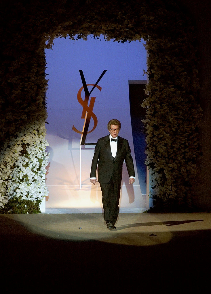 2002: Yves Saint Laurent takes a bow at his last ever couture show at Centre Pompidou in Paris.