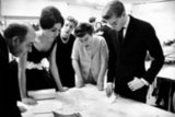 1959: Yves Saint Laurent going over a sketch with Farah Dibah, empress of Iran.