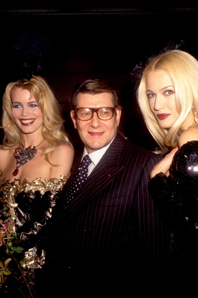 2000: Claudia Schiffer, Yves Saint Laurent, and Karen Mulder at the Miro Exhibition in Paris.