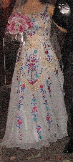 Platinum silk taffeta with embroidery in gold, platinum, fuschia, turquoise and cobalt blue.
