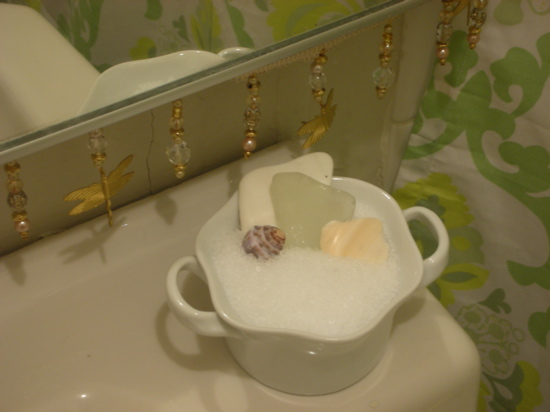 In a delicate white porcelain dish an arm's reach from the tub, I poured some bath salts. I set a few shells and sea glass from a trip to Costa Rica in the dish, which I can use to scoop the salts into the tub.