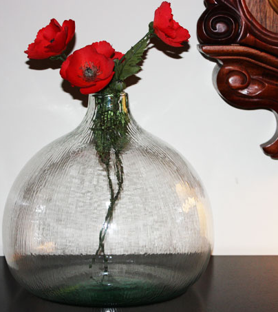 Arrange your blooms in this recycled glass balloon vase ($28), and save 15% on your order when you enter the code GREENLUV15 at the checkout through February 14th.