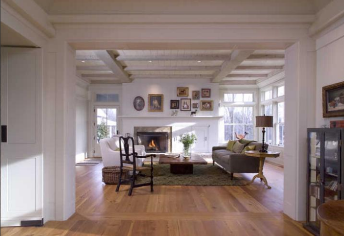 The main living spaces look out on the Cannon River. The flooring is reclaimed southern yellow pine in this room.