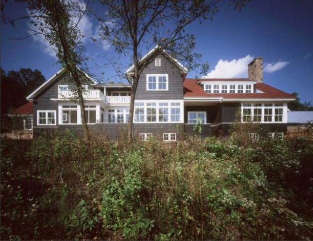 The house's dark exterior stain nods to its Scandinavian influences.