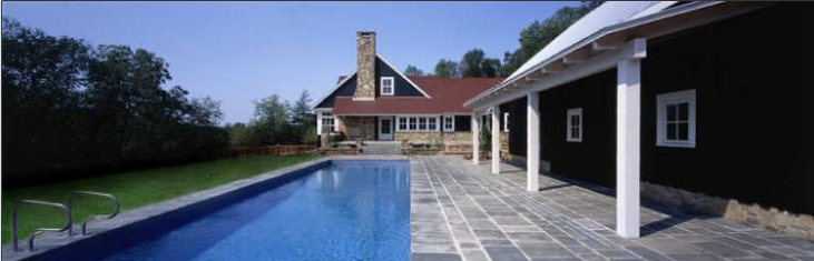 While the outdoor pool can't be used in every season given the chilly Midwestern winters, it's a welcome gathering spot in the Summer. The poolhouse and the garage, which shelter the main residence from prying eyes, was built to resemble a barn.