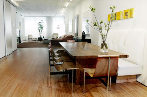 A narrowly striated wood floor is a perfect counterbalance for the substantial, wide wood table.
