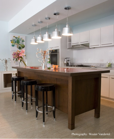 An open kitchen allows room for drinking, cooking, and socializing.