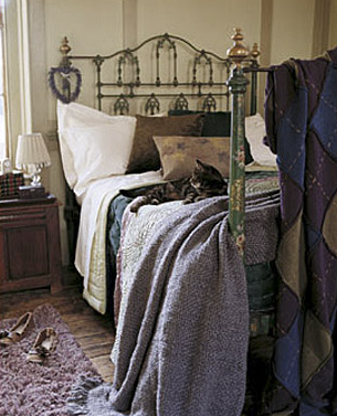 A lovingly weathered-looking wrought-iron bed exudes the sense of a life well lived under its covers.