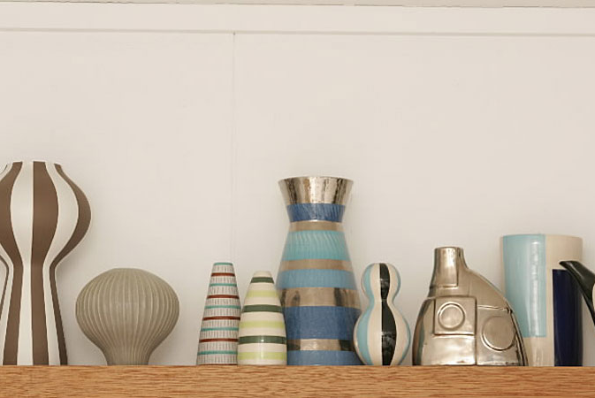 "Some of Adler's pottery designs displayed on a shelf. In the article, Doonan is quoted as saying, ""I find it very questionable when people design stuff and they don't have it at home. If Jonny makes it, we should have it."""