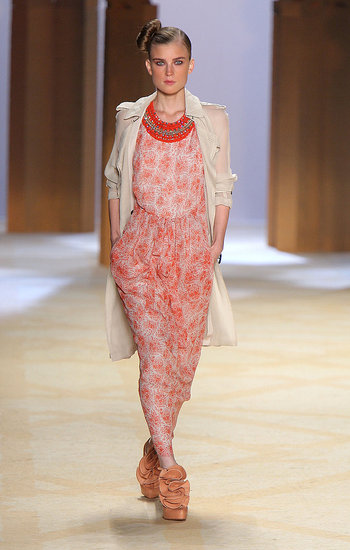 A delicate floral pattern adds overall femininity to this dress, which is contrasted by the coat and necklace.