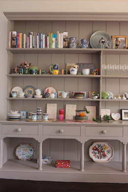 A traditional built-in is livened up with a collection of colorful dinnerware.