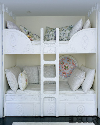 Shabby-chic bunk beds are juxtaposed with artwork by contemporary Japanese artist Takashi Murakami.