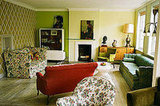 A hodge-podge of greens bring depth to this sitting room.