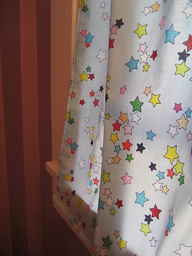 Star curtains, which Laurel sewed, add fun and color to the bathroom.