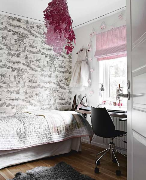 The Tord Boontje Midsummer Light matches the soft pink shade. Black and white toile wallpaper brings restrained femininity.