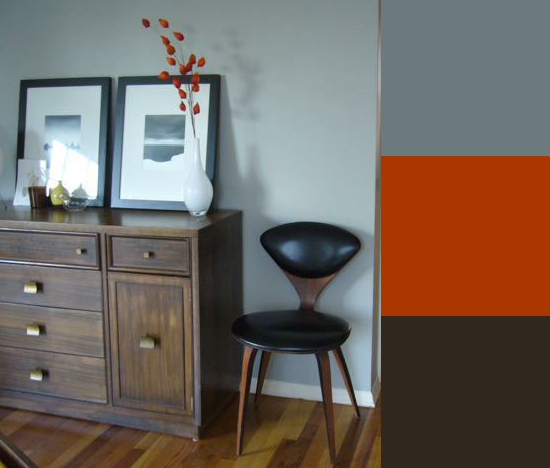 In this room, the orangey-red color of Chinese lanterns adds a punch of color to the gray and espresso palette. Source