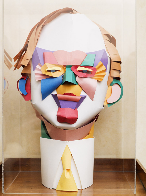 This sculpture, constructed from colored paper, lends Wolfe a clown-like air.