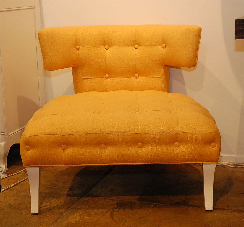 The Antiques du Monde Klismos Slipper Chair ($3,400) has the same T-shaped backrest and an equally eye-catching color.