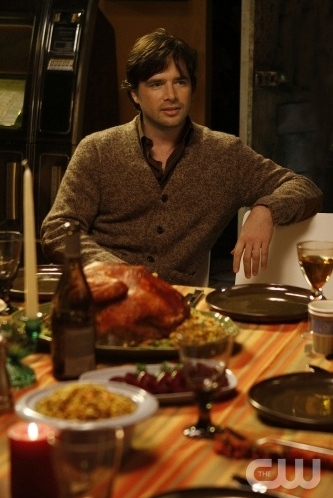 A striped tablecloth in warm tones is the perfect canvas for Rufus's Thanksgiving feast.