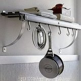 Install the Crate & Barrel Grey Wall Mounted Pot Rack ($99.95) to recreate that open air, low-key look.