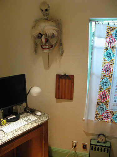 In a corner of his bedroom, Andy's modern technology butts heads with a somewhat sinister wall sculpture.