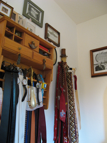 Andy's closet is terrifically well-organized. I love the top-hatted man (perhaps Lincoln?) holding up the ties.