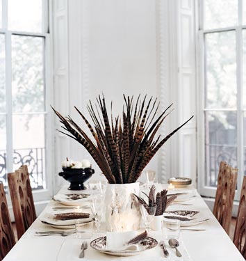 Create a bold tabletop centerpiece with a bushel of pheasant feathers.