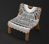 Tara Murray's Doily Chair (inquire for price) is a composite linen doily that has found its home supported on a wide walnut chair frame.