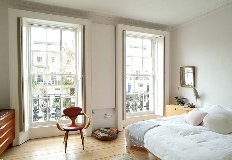 With gorgeous floor-to-ceiling windows and a balcony of your own, who needs patterned sheets?