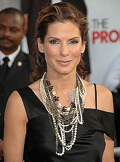 Photo of Sandra Bullock Wearing Alexander McQueen Black Dress and Chunky Necklace at Los Angeles premiere of The Proposal