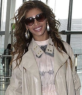 Photo of Beyonce Knowles Wearing Alexis Bittar Earrings at Heathrow Airport in London